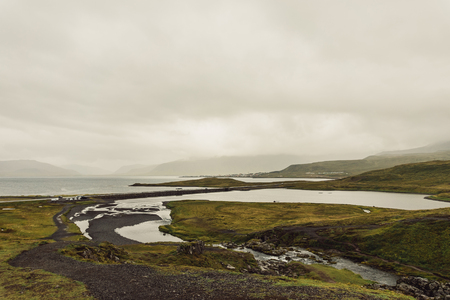 amazing landscape with river and grassy hills in Iceland