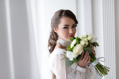 elegant smiling bride with wedding bouquet Stock Photo