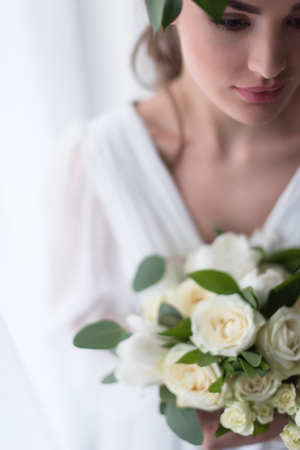 selective focus of young elegant bride with wedding bouquet Stock Photo