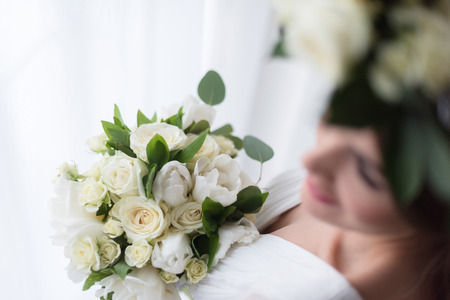 overhead view of elegant bride with white wedding bouquet