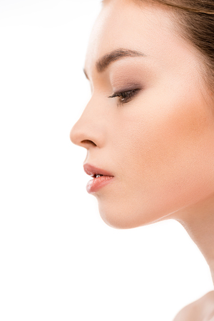 profile portrait of young woman with clean fresh skin, isolated on white Stock Photo