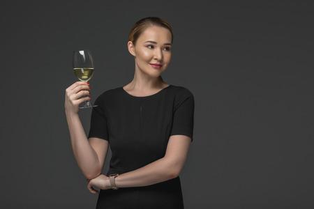 beautiful smiling kazakh woman holding glass of wine isolated on grey Stok Fotoğraf - 114264143
