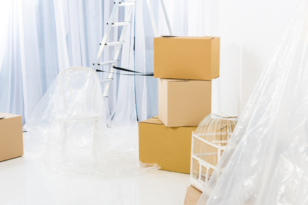 boxes and ladder after relocation to new apartment Stock Photo