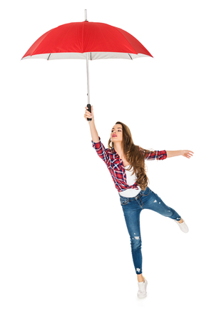 beautiful young woman holding red umbrella isolated on white Stock fotó