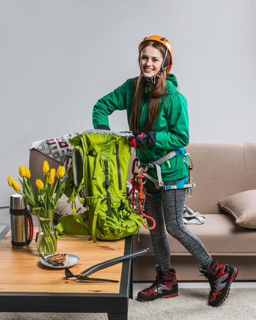 beautiful climber packing backpack for travelling at home
