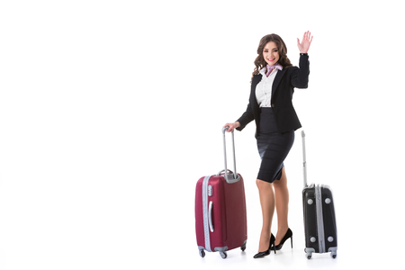 attractive stewardess waving hand isolated on white