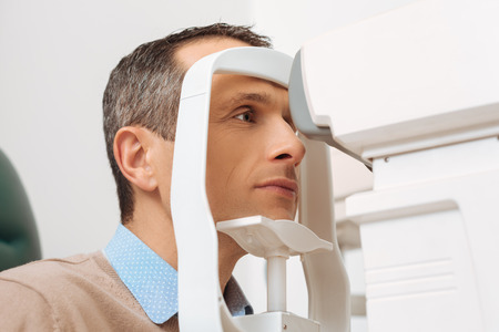 side view of patient getting eye checked in clinic