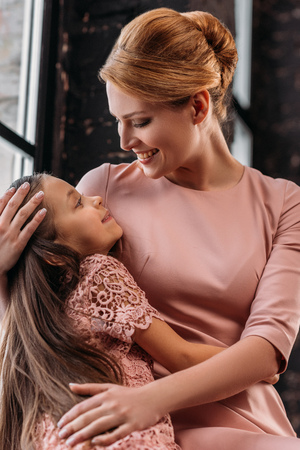 young beautiful mother embracing her little daughter Stock fotó