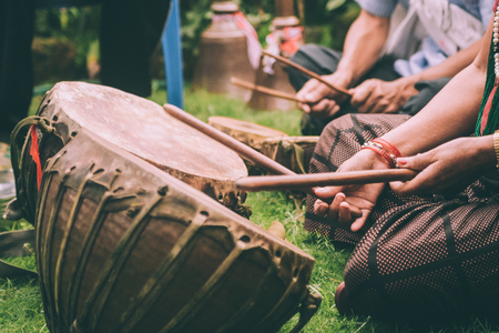 cropped shot of people playing leather drums with sticks in Nepal Banco de Imagens - 114249609