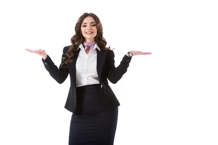 attractive stewardess showing something with hands isolated on white Zdjęcie Seryjne