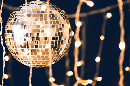 glossy disco ball with garland on black background 스톡 콘텐츠