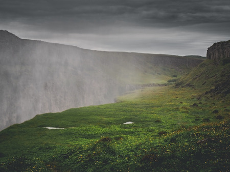 mist over the big majestic Gullfoss waterfall, Iceland