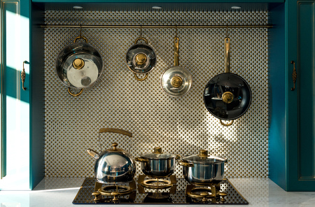 various dishware on stove and hanging in kitchen