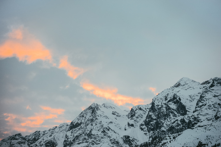 beautiful snowy mountains under sunset sky, Austria Banco de Imagens
