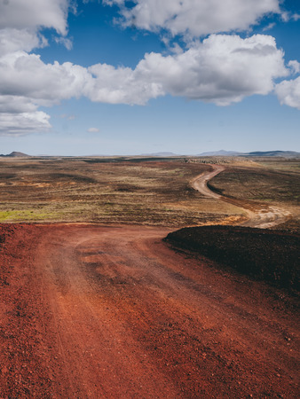 landscape with road with red volcanic sand in Iceland