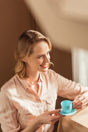 beautiful happy woman playing tea party