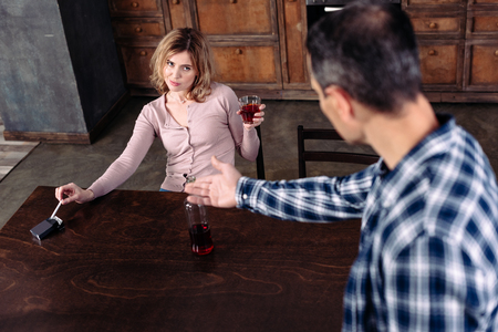 selective focus of man and drunk wife with alcohol at home
