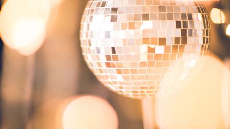 glossy disco ball with bokeh light around
