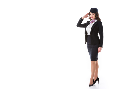 beautiful stewardess saluting isolated on white