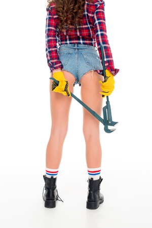 cropped view of sexy girl in gloves holding adjustable wrench, isolated on white 版權商用圖片