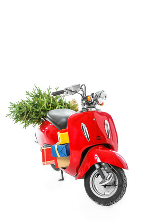 red scooter with christmas tree and gift boxes, isolated on white