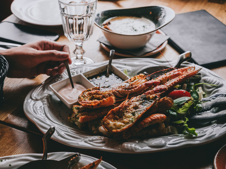 Dish with langoustine on salad with sauces in restaurant in Hofn, Iceland Stock Photo