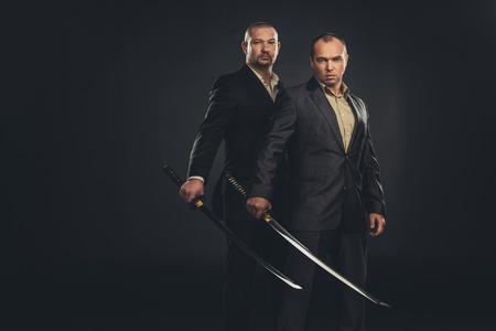 modern samurai with katana swords isolated on black