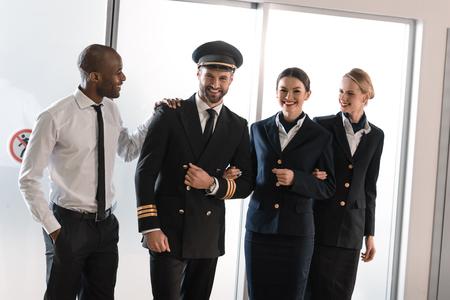 happy aviation personnel team in professional uniform Stockfoto