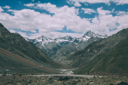 beautiful mountain valley with road and snow capped peaks in Indian Himalayas, Ladakh region Stock Photo - 114326457