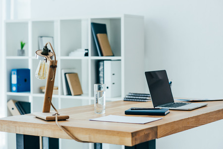 interior of modern office with stylish table lamp
