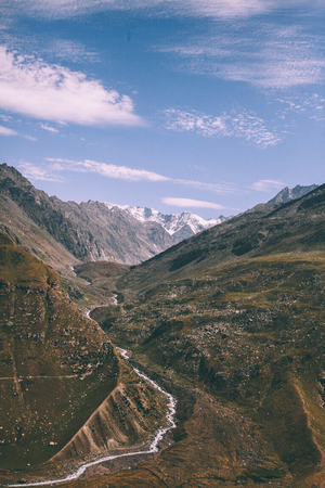 majestic mountain valley with river in Indian Himalayas, Rohtang Pass