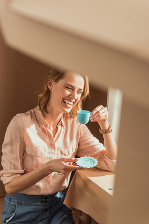 attractive happy woman playing tea party