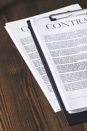 juridical contract documents on wooden table, law concept