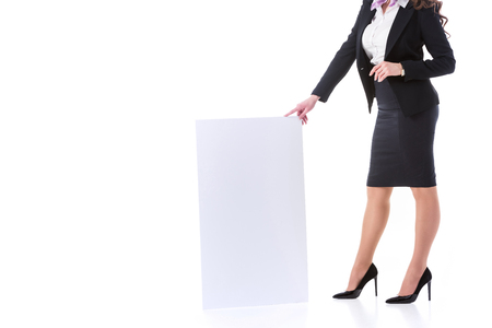 cropped image of stewardess holding empty board isolated on white Foto de archivo