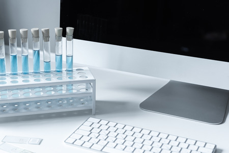 test tubes with blue liquid on working table