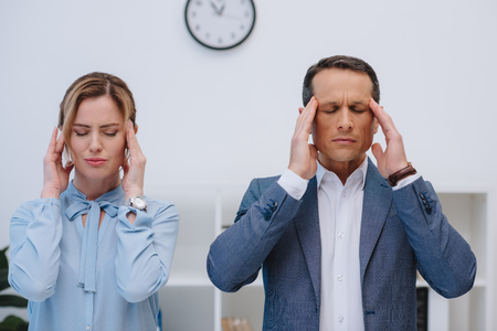 mature managers with headache at modern office Imagens