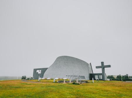 Modern church, concrete construction, with a large cross, new parish church, Bloendus, Blonduos, Iceland Reklamní fotografie
