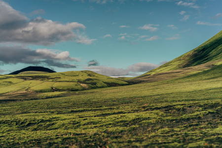 beautiful scenic landscape with green hills in Iceland