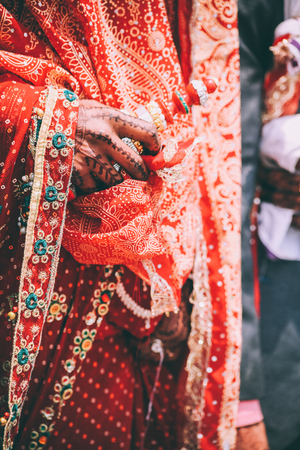 cropped shot of person in traditional festive clothes holding prayer wheel, Indian Himalayas, Rohtang Pass