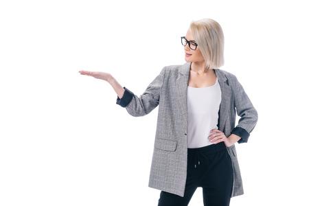 beautiful stylish businesswoman presenting something, isolated on white
