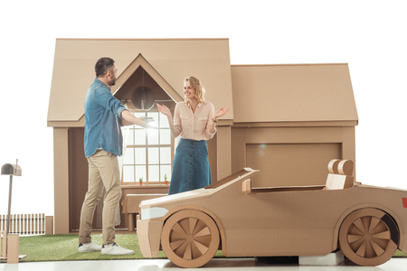 man presenting cardboard car to his girlfriend for birthday isolated on white isolated on white 스톡 콘텐츠