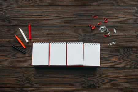 top view of arranged blank calendar, pencils, clips and pins on wooden tabletop Stock Photo