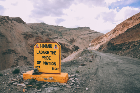 close-up view of sign on mountain road in Indian Himalayas, Ladakh region Stock Photo
