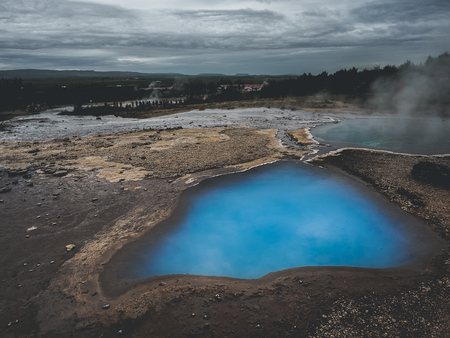 Thermal lake Blesi and Strokkur Geysir, Golden circle route in south Iceland