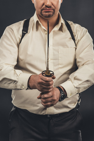 cropped shot of yakuza member holding japanese tanto knife in hands 写真素材