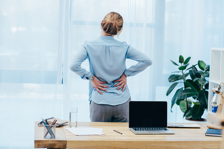 rear view of businesswoman with backplain in office Stockfoto