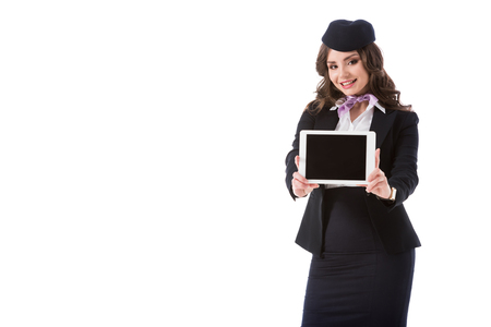 smiling stewardess showing tablet with blank screen isolated on white Stock Photo
