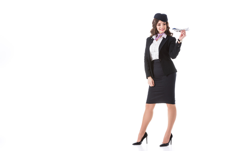 beautiful stewardess playing with plane toy isolated on white