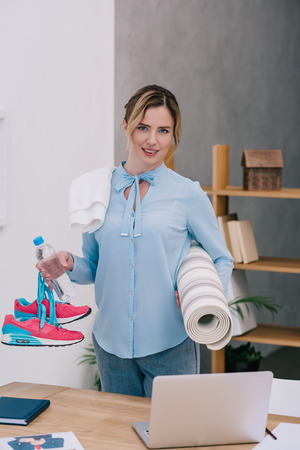 attractive businesswoman with fitness equipment at office Stock Photo