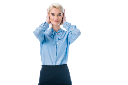 portrait of woman covering ears with hands isolated on white Stock Photo